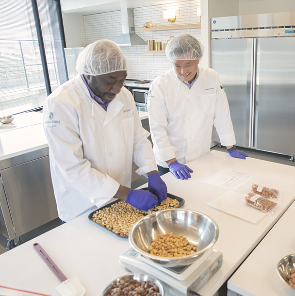 food scientists in test kitchen evaluating product quality