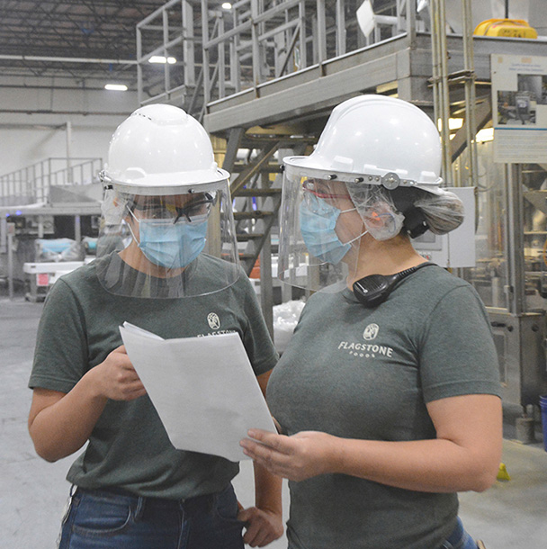 Two employees from Flagstone El Paso reviewing paperwork