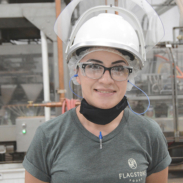 Employee from Flagstone El Paso plant smiling for camera
