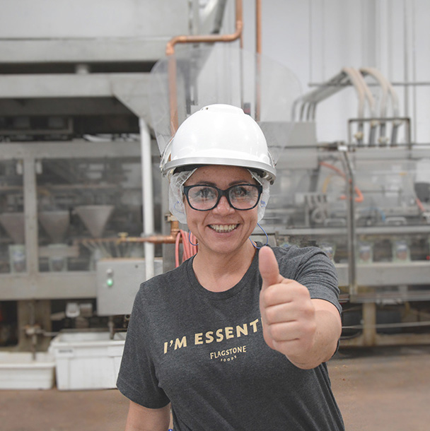 Employee from Flagstone El Paso plant - smiling and giving a thumbs up